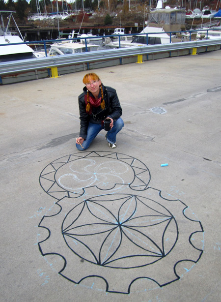 Liz LaManche painting on the pier at HarborArts