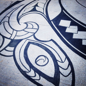 Bird, detail of tattoo design at HarborArts, copyright Maoriarts.com, executed in concrete by Liz LaManche