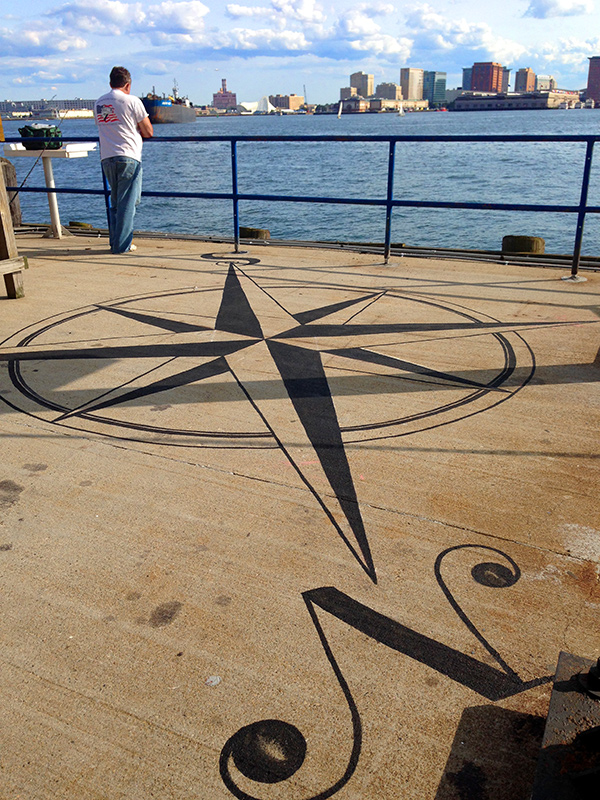 Compass Rose, complete, with fisherman.