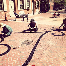 "Tattoo being added to the central plaza at Derby Square, Salem: Part of ""Salem's Connected World"" by Liz LaManche"