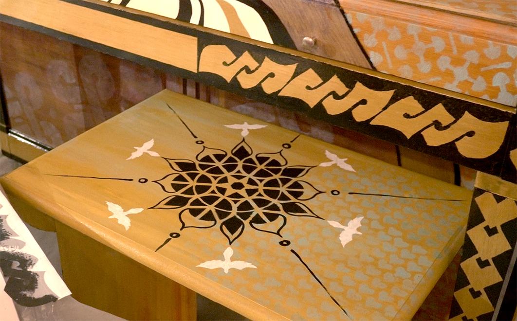 Vhair with mandala, heart pattern and doves, piano with Maori pikorua, Hawaiian taro leaf border.