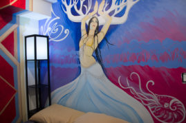 Zoe Jakes room with dancing forest figure as bedstead