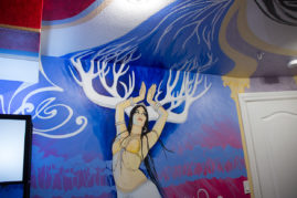Zoe Jakes room with dancing forest figure that continues onto the swirl of the ceiling